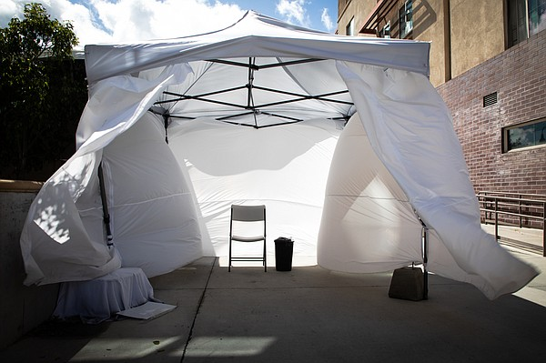 Wind blows through an empty isolation tent set up for pat...