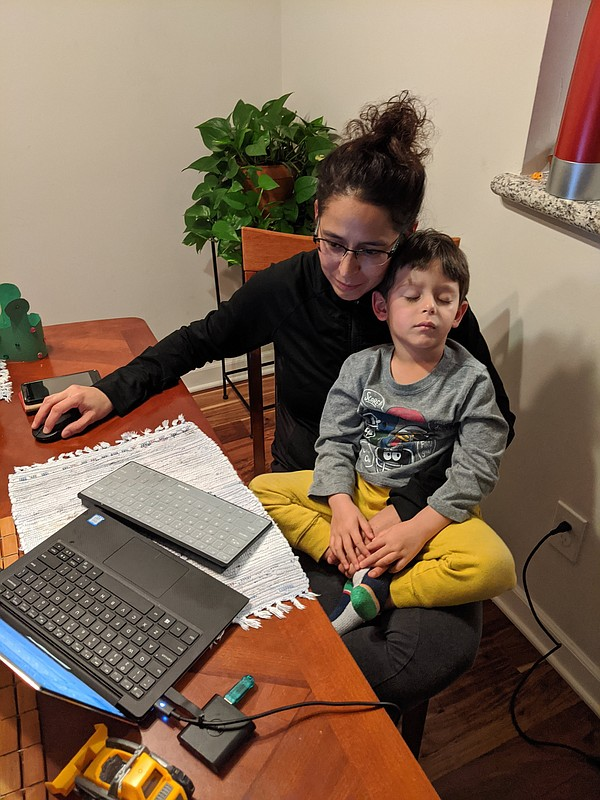 Julia Najera attempts to work from home with her son in h...