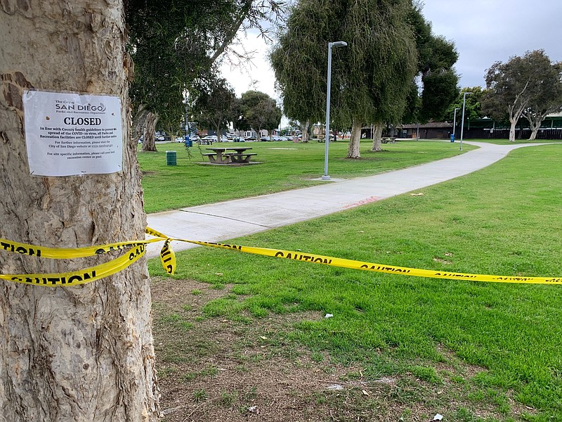A closed sign is posted to a tree at North Park Community Park, April 20, 2020.
