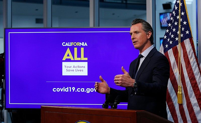 n this photo taken Tuesday, April 14, 2020, Gov. Gavin Newsom discusses an ou...
