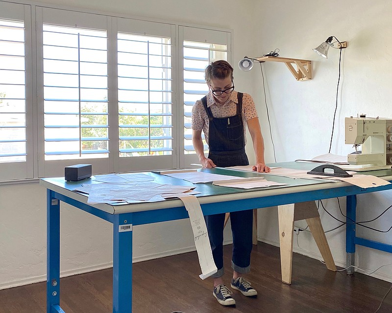 Sugardale's founder Trista Roland works on a pattern in her studio in an unda...