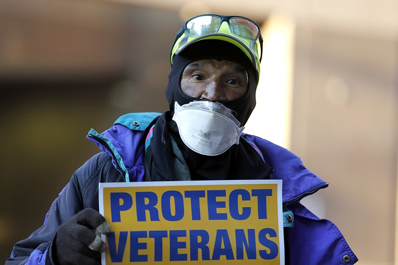 Clarence Shields, an Army veteran, pickets with a small group of activists fr...