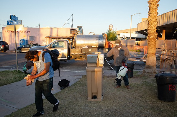 A man walks away from a hand-washing station in Calexico'...