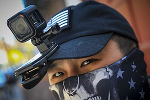 Photo for From Guns To GoPros, Asian Americans Seek To Deter Attacks