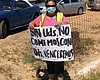 A supporter of farm-workers in San Diego holds ...