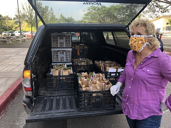 Nan Sterman shows the daily supply of Grab and Grow Garde...