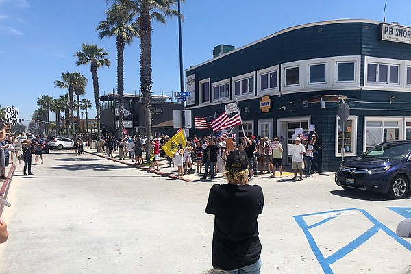 Protesters gather in Pacific Beach in opposition to Calif...