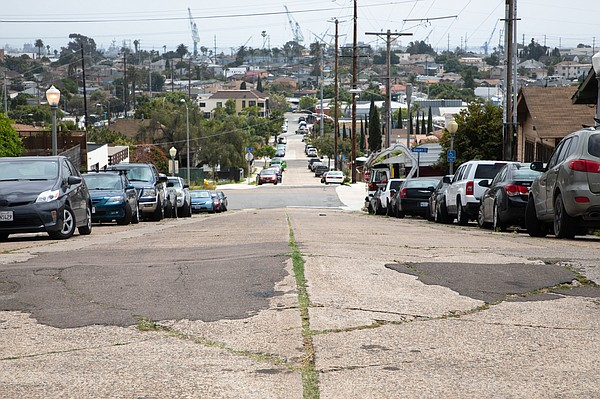 A stretch of road with patches and cracks in San Diego's ...