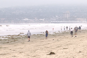 Photo for Californians Mostly Keeping Social Distance Protocol at Beaches, Police Say