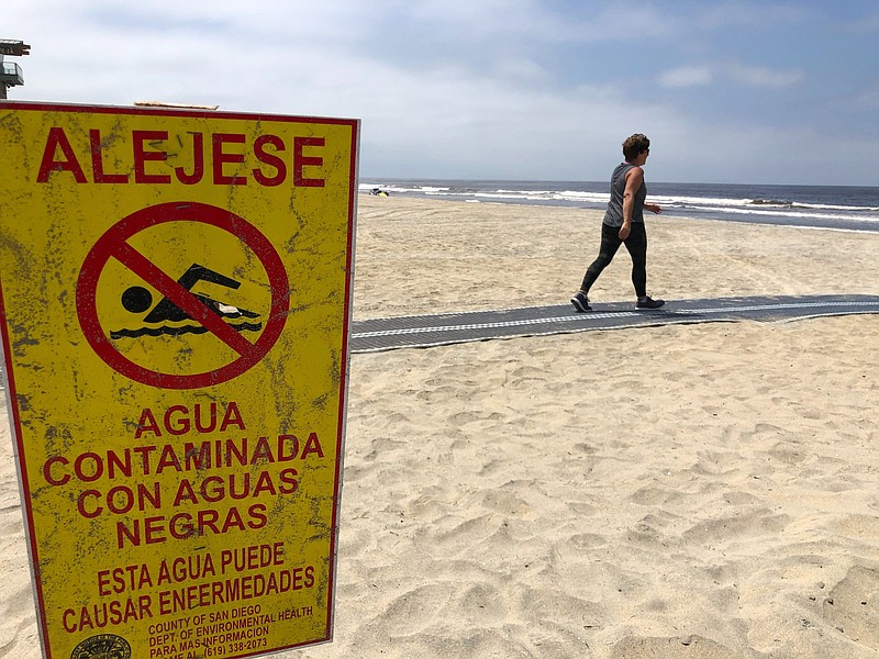 Pedestrians return to Imperial Beach after sand was closed because of COVID 1...