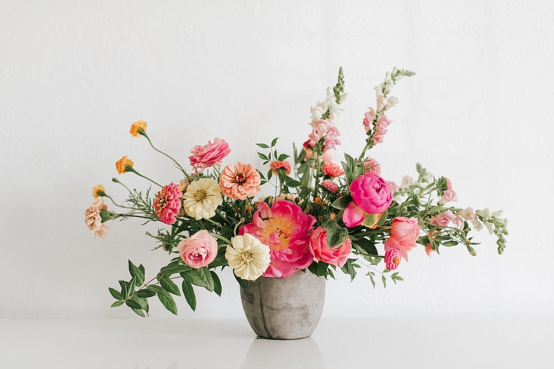 A Native Poppy arrangement is pictured in an undated photo. The local floral ...