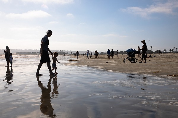 People return to Coronado Beach with social distance rest...