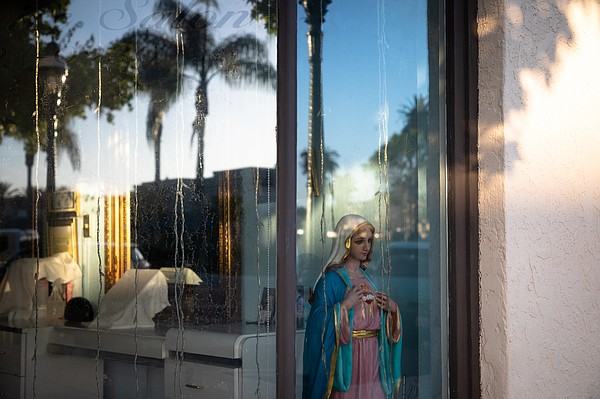 The window of a closed salon on Third Street in Chula Vis...