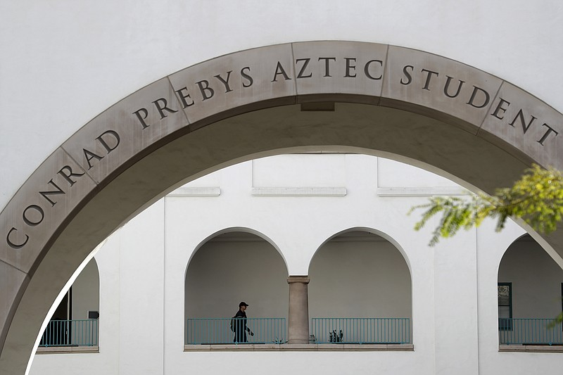 A student walks on the San Diego State University campus Thursday, March 12, ...