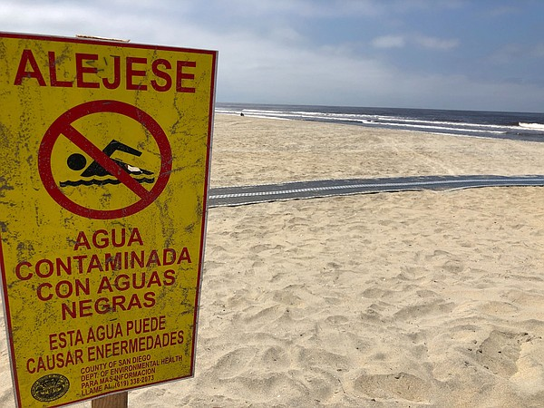 Pollution warning sign in Imperial Beach, a region that h...