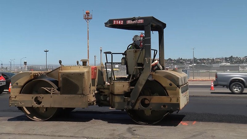 A construction worker repaving North Harbor Drive in downtown San Diego on Ma...