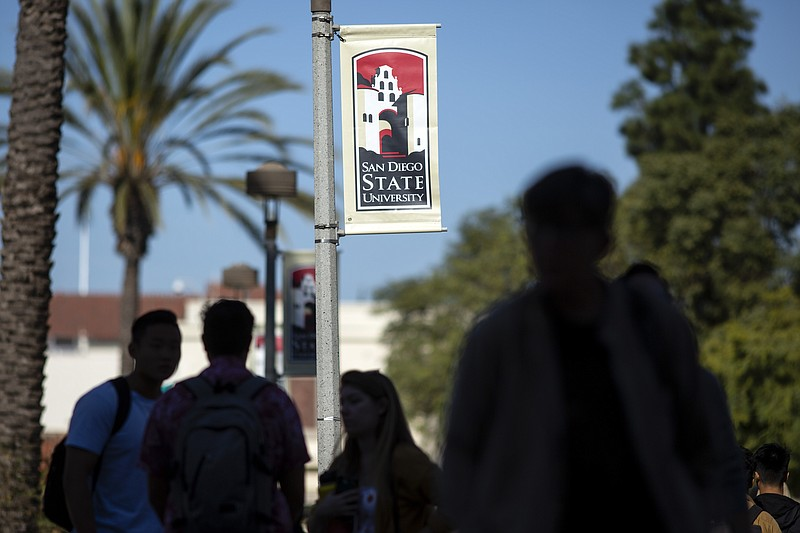 People walk on campus at San Diego State University Tuesday, Nov. 12, 2019, i...