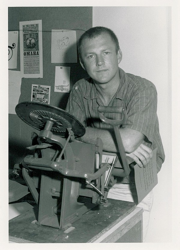 Bob Matheny, circa 1959, pictured with a letterpress.