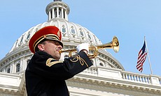 "A bugler plays ""Taps"" in honor of our fallen he..."