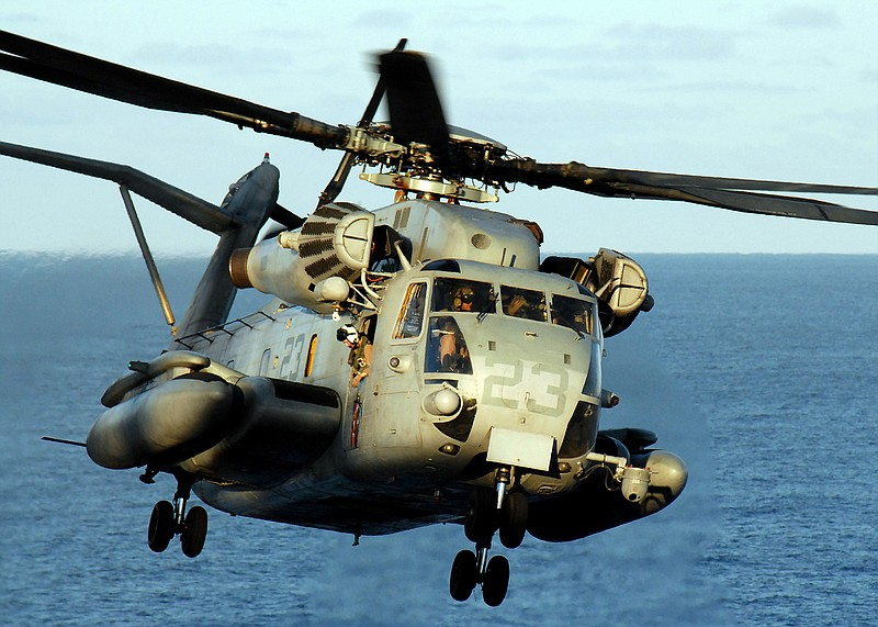 A CH-53E Super Stallion helicopter lands on the flight deck of the USS Peleli...