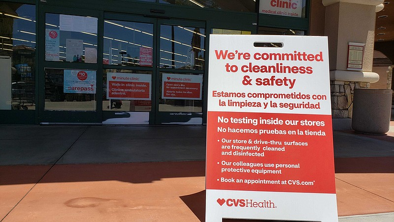 A testing sign is posted outside of a Chula Vista CVS store, May 21, 2020.