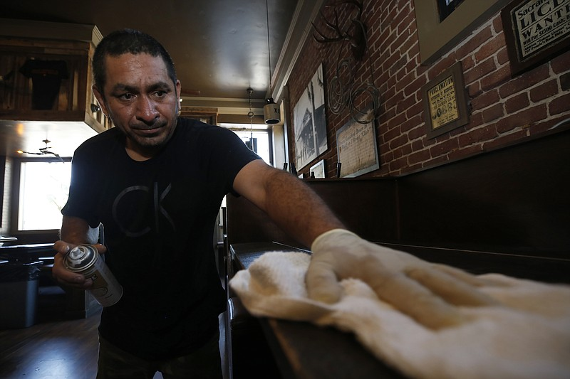 Miguel Colio cleans tables at the Goldfield Trading Post restaurant in Sacram...