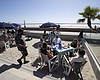 People sit at tables at the Beach House Grill T...
