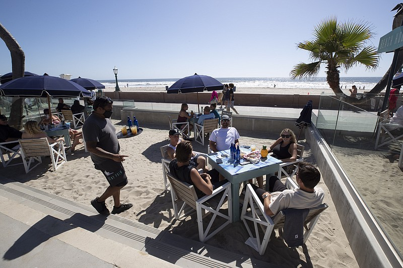 People sit at tables at the Beach House Grill Thursday, May 21, 2020, in San ...