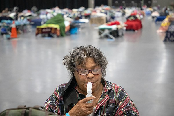 Deborah Jackson, who's been homeless for five years, uses...