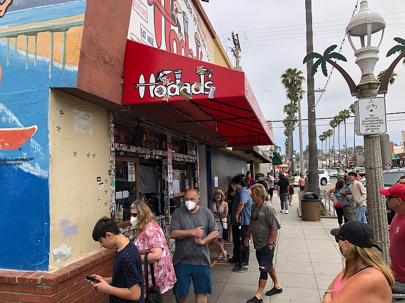 Customers line up outside of Hodad's in Ocean Beach during the Memorial Day w...