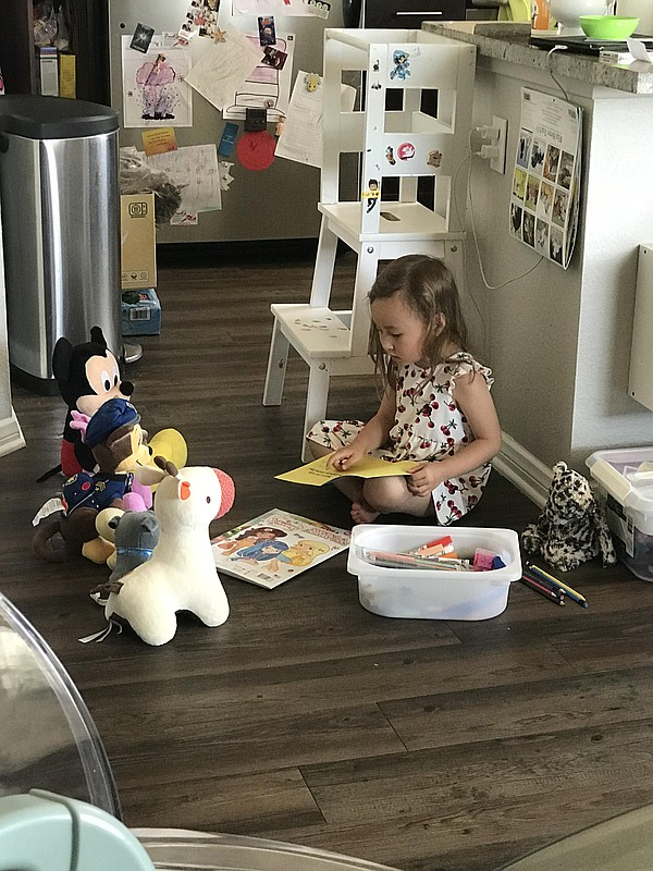 Aaron Jacobson's daughter Amelia plays alone at home in t...