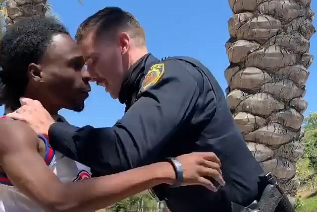 A still from a video of Amaurie Johnson being detained by a La Mesa police of...