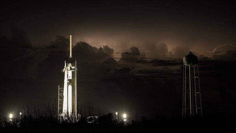 The Dragon crew capsule sits atop a Falcon 9 rocket on Friday, May 29, 2020 a...