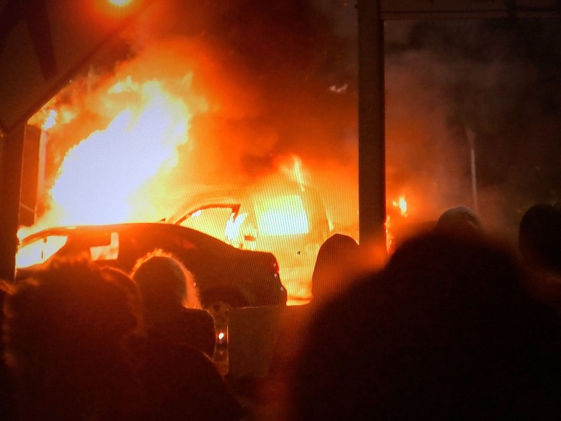 A vehicle engulfed in flames in front of La Mesa City Hall on May 30, 2020, a...