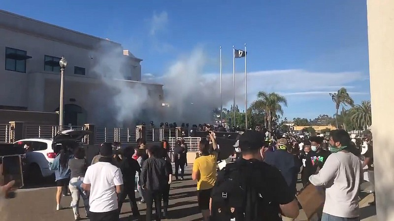 San Diego Sheriff's Department deploying tear gas into the crowd of protester...