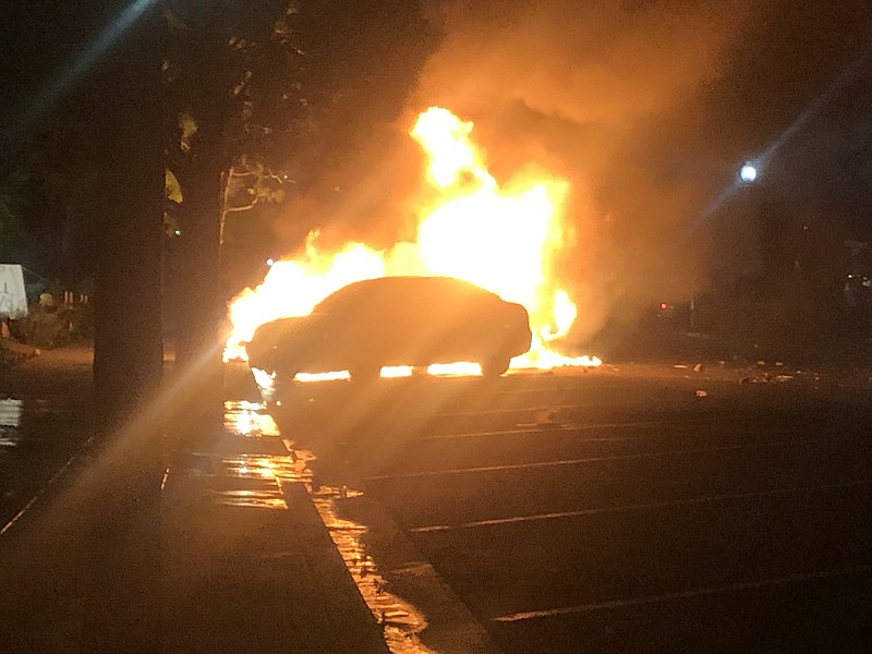 A vehicle on fire in La Mesa, May 30, 2020.