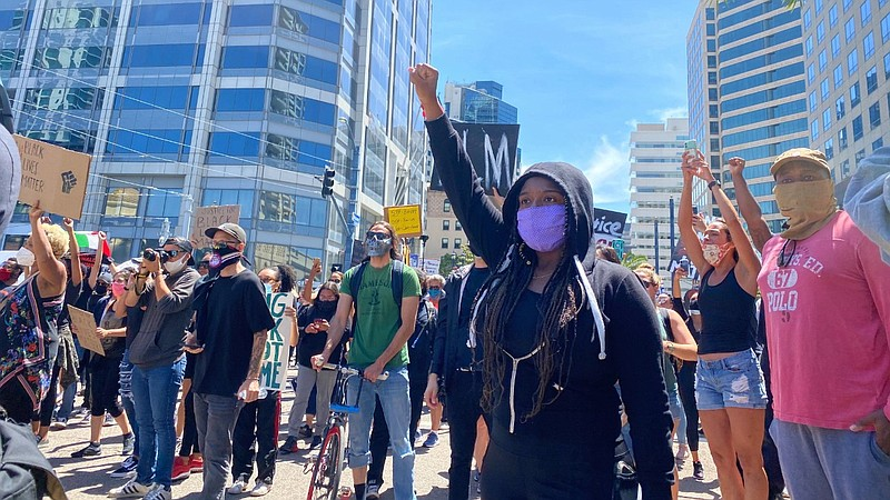 A protester giving the black power salute in downtown San Diego on May 31, 20...