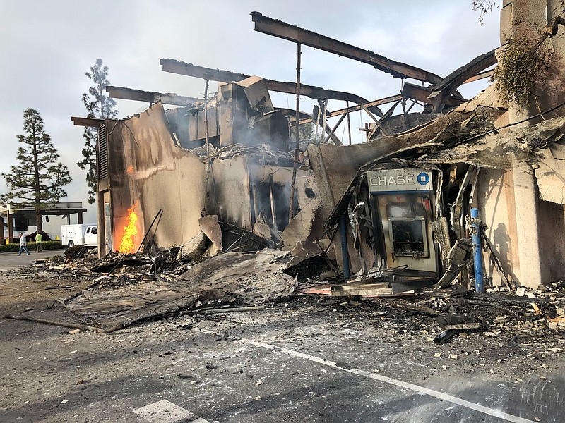 Small flames still burn at Chase bank location on Spring Street in La Mesa th...