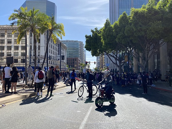 Police fire tear gas at protesters in downtown San Diego,...
