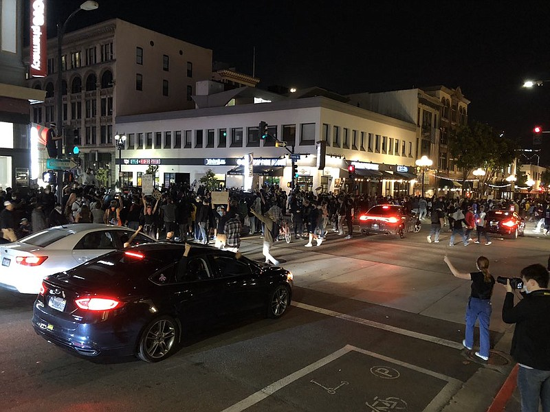 Protesters marching through to streets of downtown San Diego on May 31, 2020,...