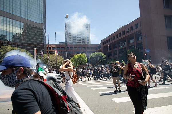 Protesters flee after San Diego police fire tear gas and ...