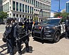 San Diego police officers stand guard on Broadw...