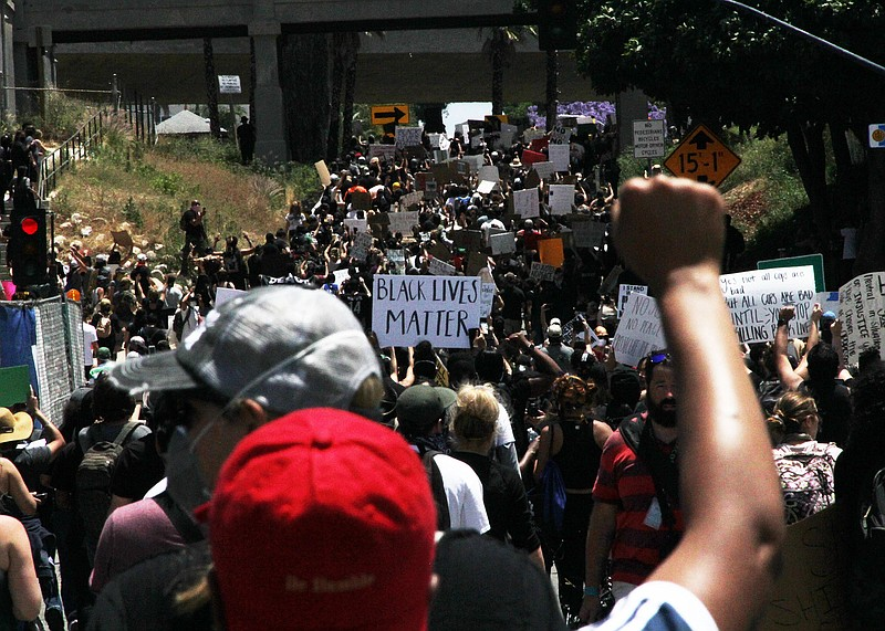 A group of demonstrators march towards downtown San Diego, May 31, 2020.