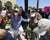 Escondido residents take a knee to protest the ...