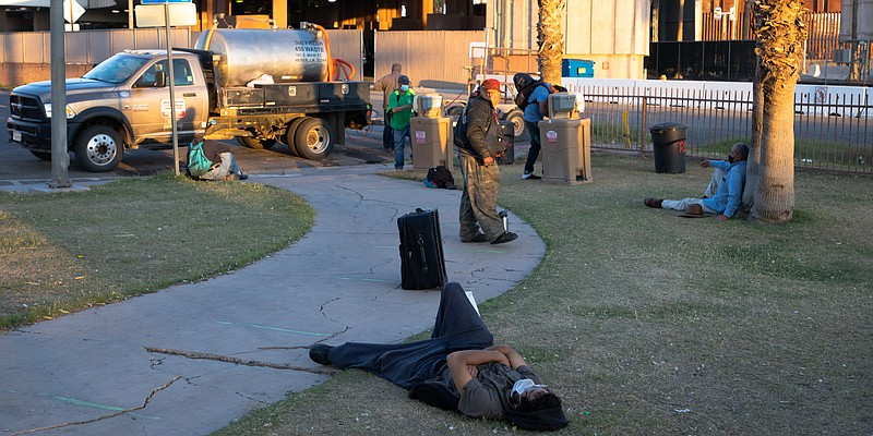 People wait in Calexico's Border Park before receiving dinner from the Brown ...