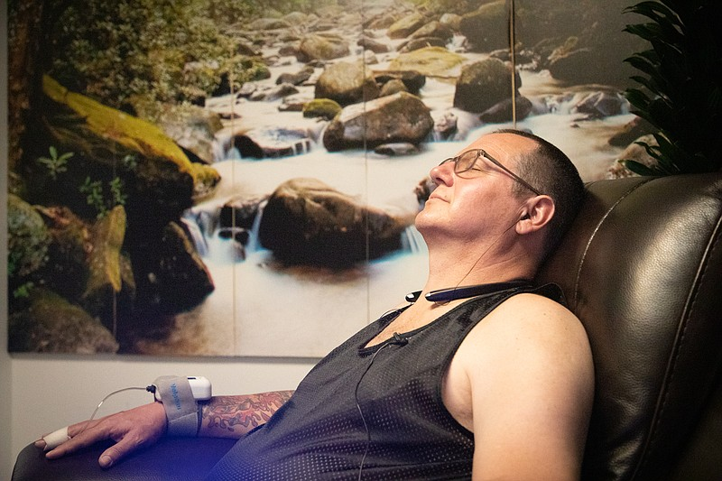 Navy veteran Larry McMinn relaxes before receiving a ketamine treatment at Ka...