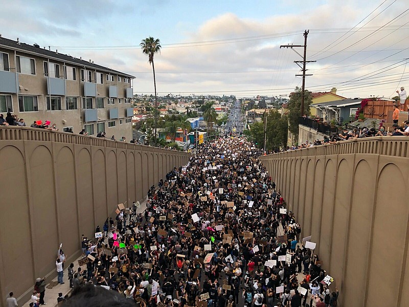 An estimated 2,000 protesters crowded University Avenue in North Park on June...