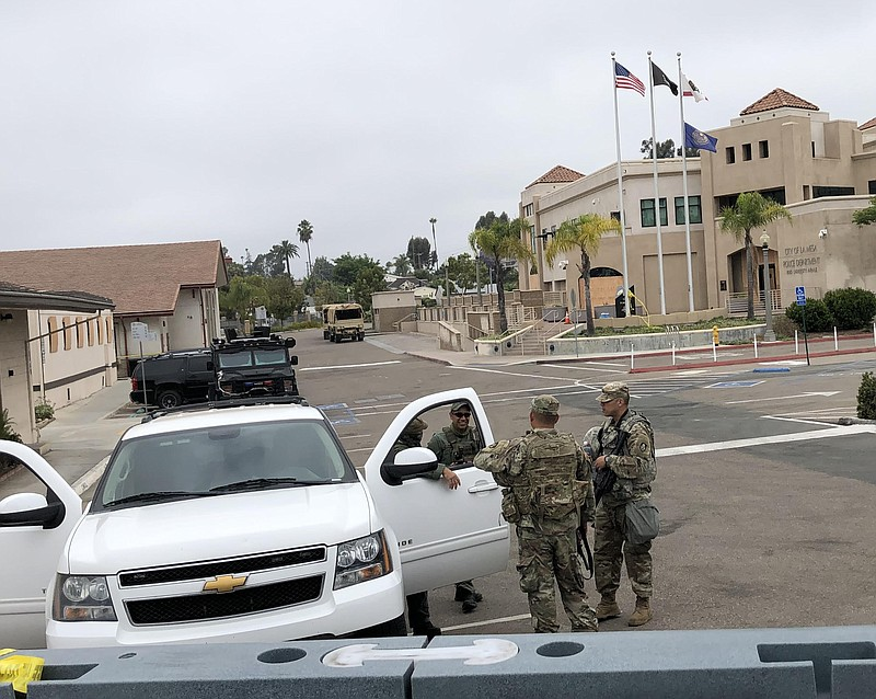 Members of the California National Guard are among the uniformed presence in ...
