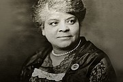 Ida B. Wells wearing a button she created to publicize a memorial service for...