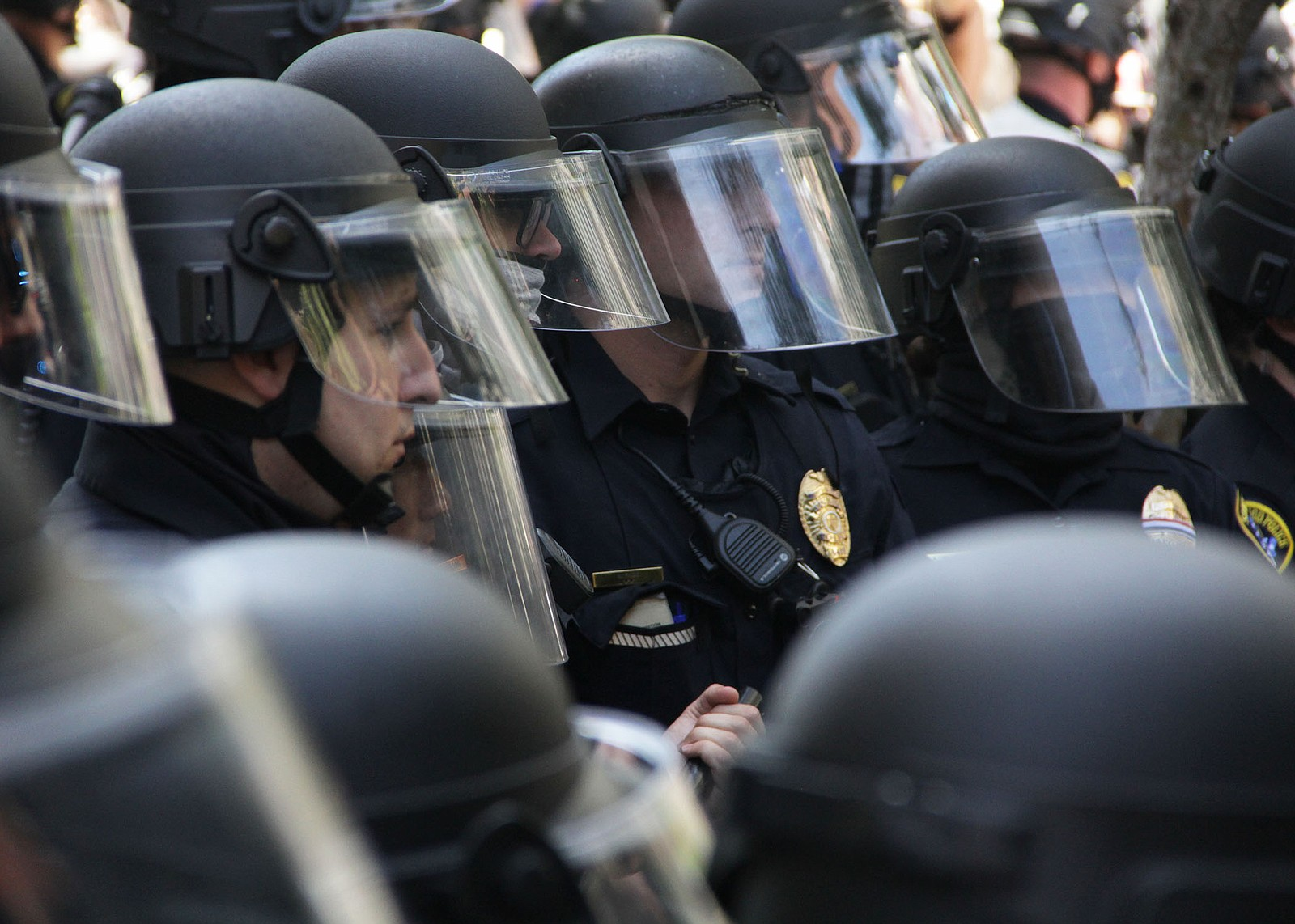 San Diego police officers monitor protesters during a demonstration against p...
